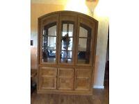 Solid oak unique display cabinet .