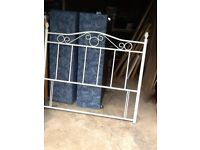 White metal headboard and double bed base