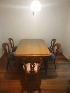 Ornate timber dining set