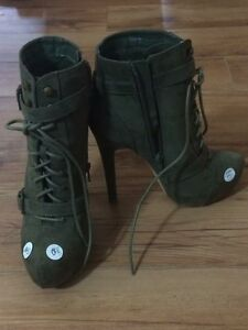Laced zip up high heel boots size 9.5