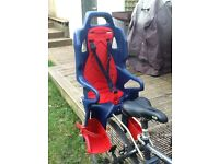 Baby or young child seat for adult bike. Very easy to use and adjust to different child sizes.