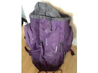 Large back pack for sell, perfect for travelling. Purple, with attached raincover and whistle.