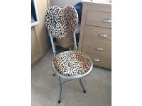 Folding leopard chair with heart shaped back