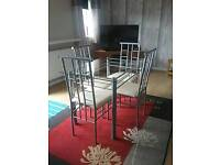 Glass top table & four chairs
