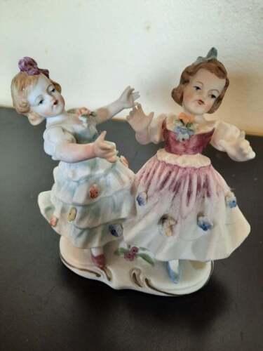 Vintage Capodimonte ? porcelain figurine of 2 young ladies dancing.