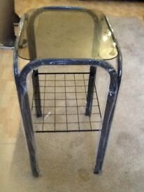 Tall glass table with Shelf Matching coffee table available new