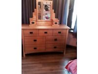 Large wooden chest of drawers and matching mirror