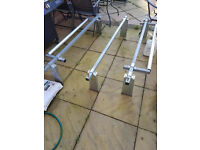 Heavy Duty Roof Bars with 2 rollers. Will fit any van with gutters.