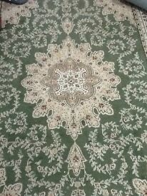 A pair of Green colored rugs