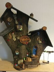 Handmade log fairy houses
