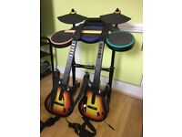 Wii Rock Band Drumkit and 2 x Guitar Hero Guitars