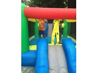Bouncy castle, little castle with a slide and other playing areas