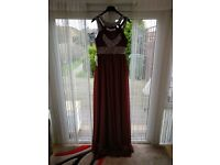 Size 14. New with tags, unworn. Beuatiful prom,evening, bridesmaid gown.