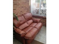 2 seater sofa,brown leather.