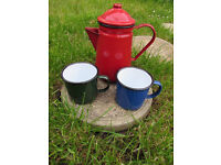 Enamel coffeepots and teapots and 2 cups