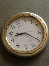 Wall clock with silver and golden in Matt finish, works with one Battery