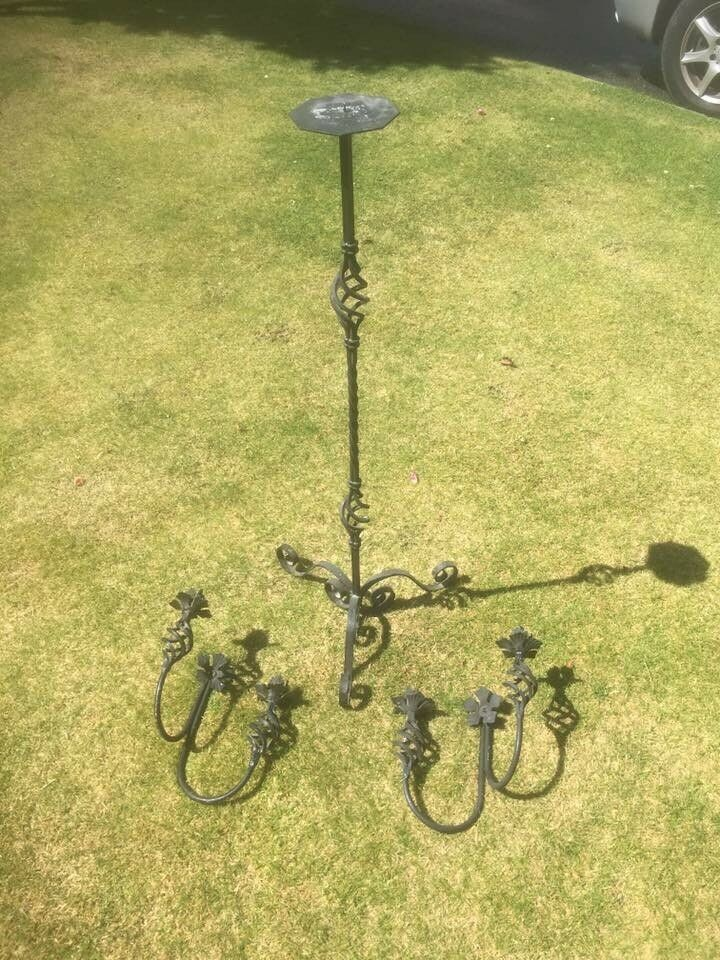 Tall Wrought Iron Style Candle Holder with Marching Sconces.