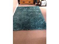 Turquoise glitter rug