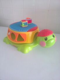 Fisher-Price Peek a Blocks Build & Spill Musical Turtle has 2 shapes out of 3 takes