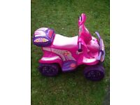 Childrens pink ride on