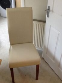 6 dinning room cream leather chairs .