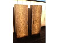 2 Matching leopard print twin cabinet , suitable for a bathroom or office.