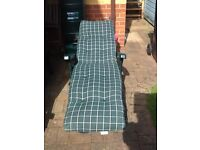 Two multi position sun lounger deckchairs with cushions