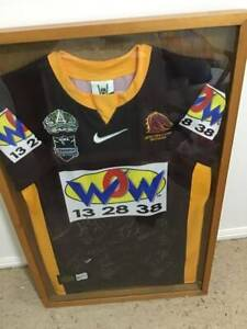 Framed Autographed Broncos Footy jersey