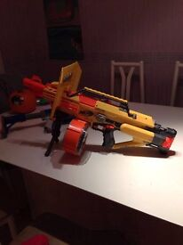 Nerf Gun Stampede ECS With Dart Drum, stand, and shield plus one other gun amo packs and bullets
