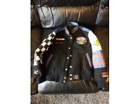 Reversible part leather Nascar jacket. Bought from the US. Approx size 7-9 years. Collect only.