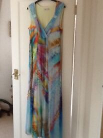 Ladies full length dress . Lovely rainbow colours. Size 14. Never worn.
