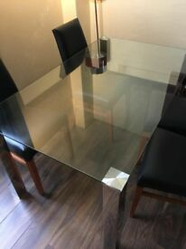 Hotel clearance - Like New Glass Kitchen table with 4 black leather dining room chairs