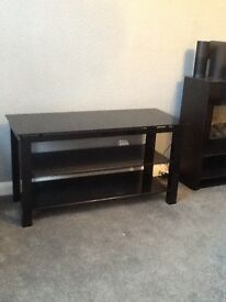 TV stand and matching coffee table in black glass