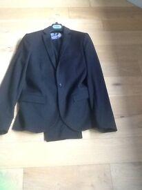 Man's black slim fit suit