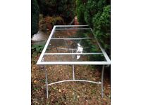 Silver and glass dining table