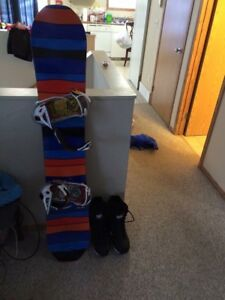 2 snowboards with bindings bag and boots