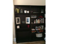 Pair of black IKEA Billy bookcases shelves