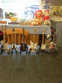 Little heroes guitars by the The Baby Axe Co.all boxed in perfect condition...ideal Xmas present