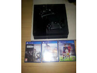 ps4 with 2 controllers and 3 games