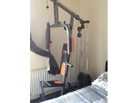 Multi gym with weights in excellent condition