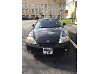Black 2003 Hyundia Coupe