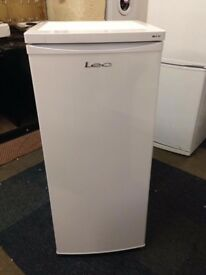 white lec tall fridge with freezer section