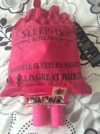 Pink sleep in hair rollers