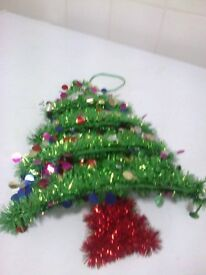 hanging colourfall Christmas decoration in a shap of a tree only used once