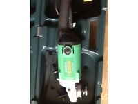 Hitachi angle grinder, with 2 diamond cutting blades and case NEVER USED