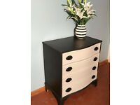 Stunning and unique chest of drawers with bowed front edge.