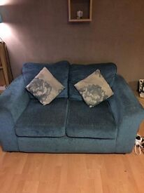 Teal 2 seater sofa with cushions