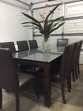 Solid timber dining table and 8 leather chairs Bendigo Bendigo City Preview
