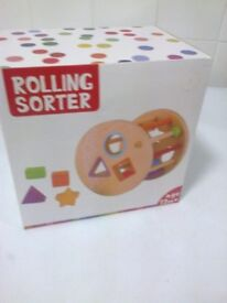 boxed wooden rolling sorter has 6 shapes age 12 mths brand new
