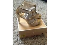 Amazing Michael Kors Gold High Heeled Sandal